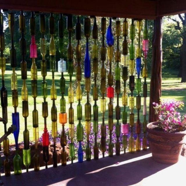 Wine bottle wall? A trellis that would look pretty in the wintertime.