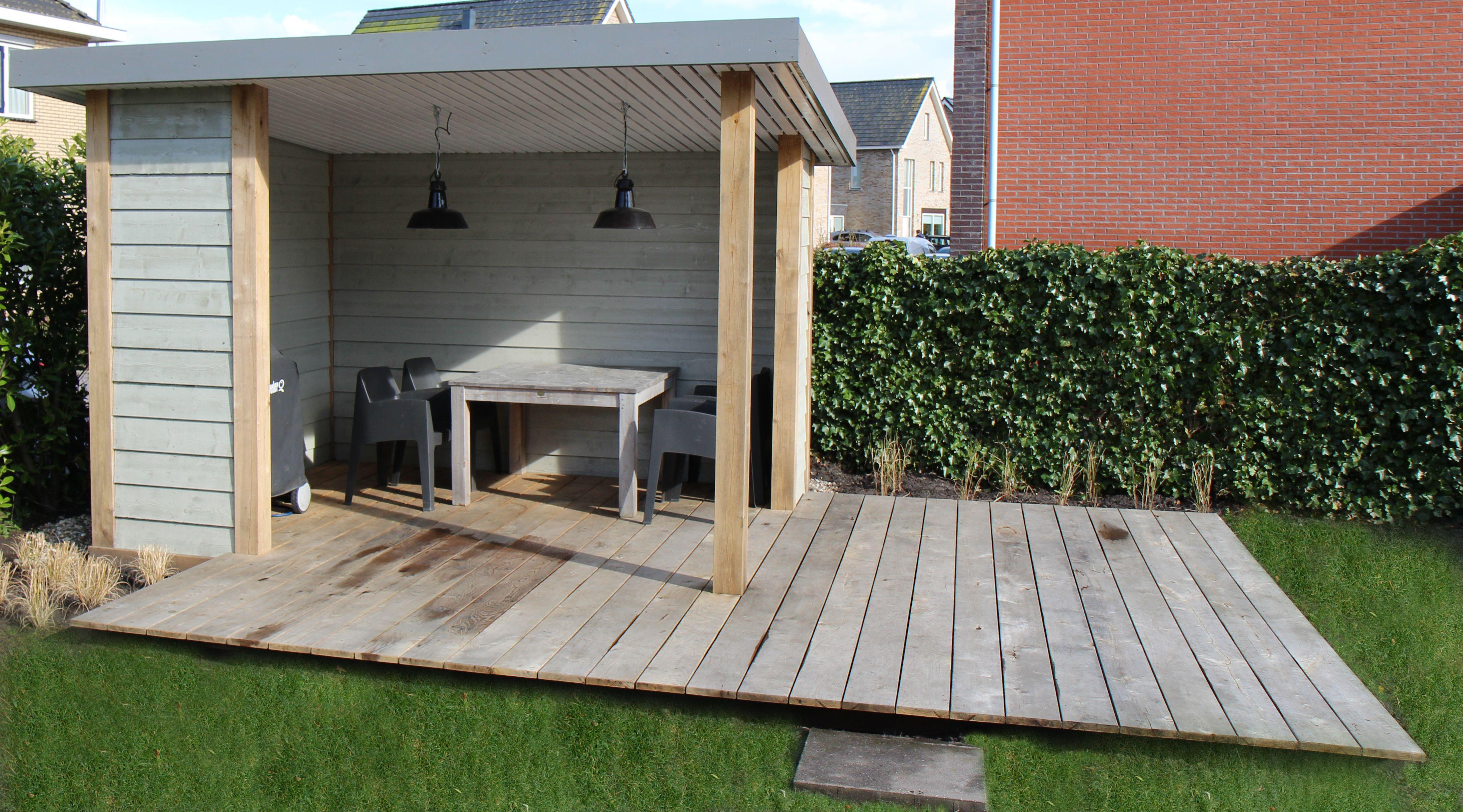 Sfeervolle overkapping met eiken vlonder ontwerp en aanleg hoveniersbedrijf van els cker tuin - Luifel ontwerp voor patio ...