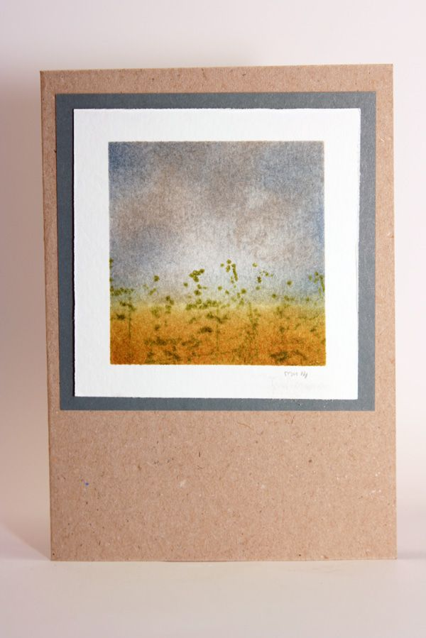 water colored field with distress inks
