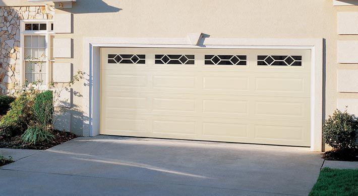 Traditional Long Panel With Waterford Windows In Almond Garage Door Styles Contemporary Garage Doors Garage Doors
