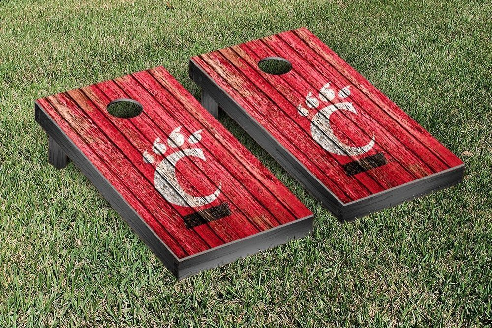 University of New Mexico Lobos Reclaimed Wood w/ Triangle Bag Toss Game Set  from Team Sports. Click now to shop College Recreation Cornholes. - Cincinnati Bearcats Weathered Wood W/ Logo Cornhole Board & Bag