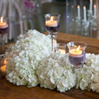 Tall fluted votives…  www.stemfloral.com  I  www.stellaalesi.com