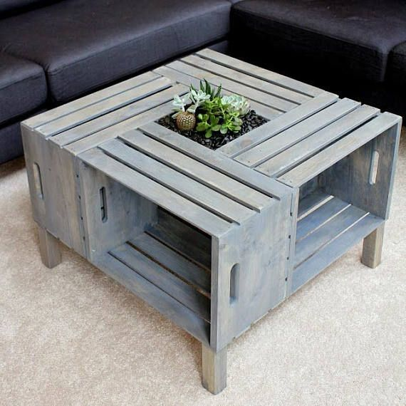 This coffee table is made with four wooden crate and has a beautiful