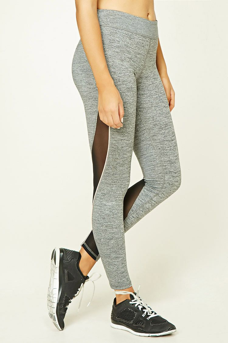 An athletic pair of marled knit leggings featuring mesh paneling, contrast piping down the sides, hidden key pocket.