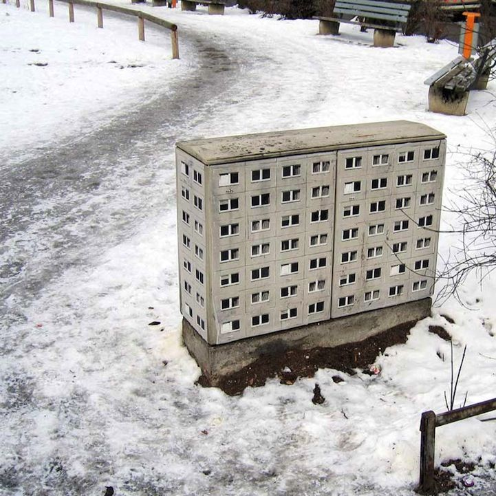 Artist Stencils Miniature Apartment Buildings on the Street