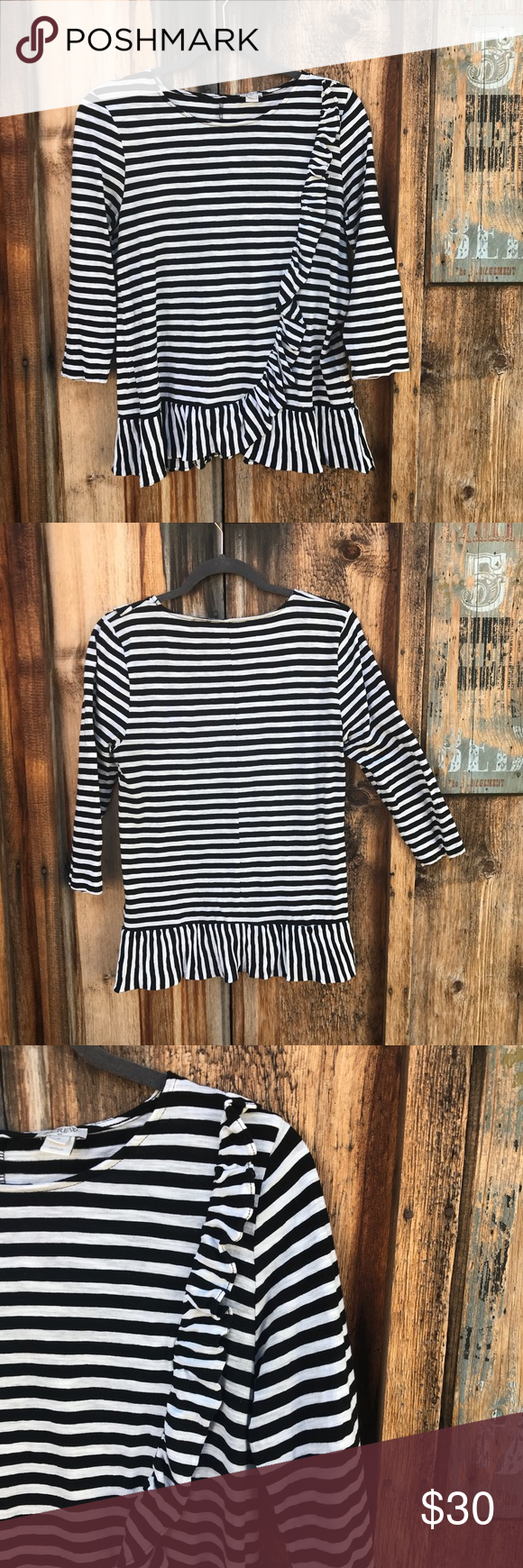 """J Crew Striped Cotton Top White top with black stripes and ruffle detail. Pair with most any color skinny jeans and ankle boots as we head into fall. Great condition. Shoulder to hem 25"""". Armpit to armpit 17"""". 100% cotton yet lightweight enough to have stretch. J. Crew Tops #skinnyjeansandankleboots J Crew Striped Cotton Top White top with black stripes and ruffle detail. Pair with most any color skinny jeans and ankle boots as we head into fall. Great condition. Shoulder to hem 25"""". Armpi #skinnyjeansandankleboots"""