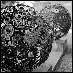 A photo of a sculpture made of gears.