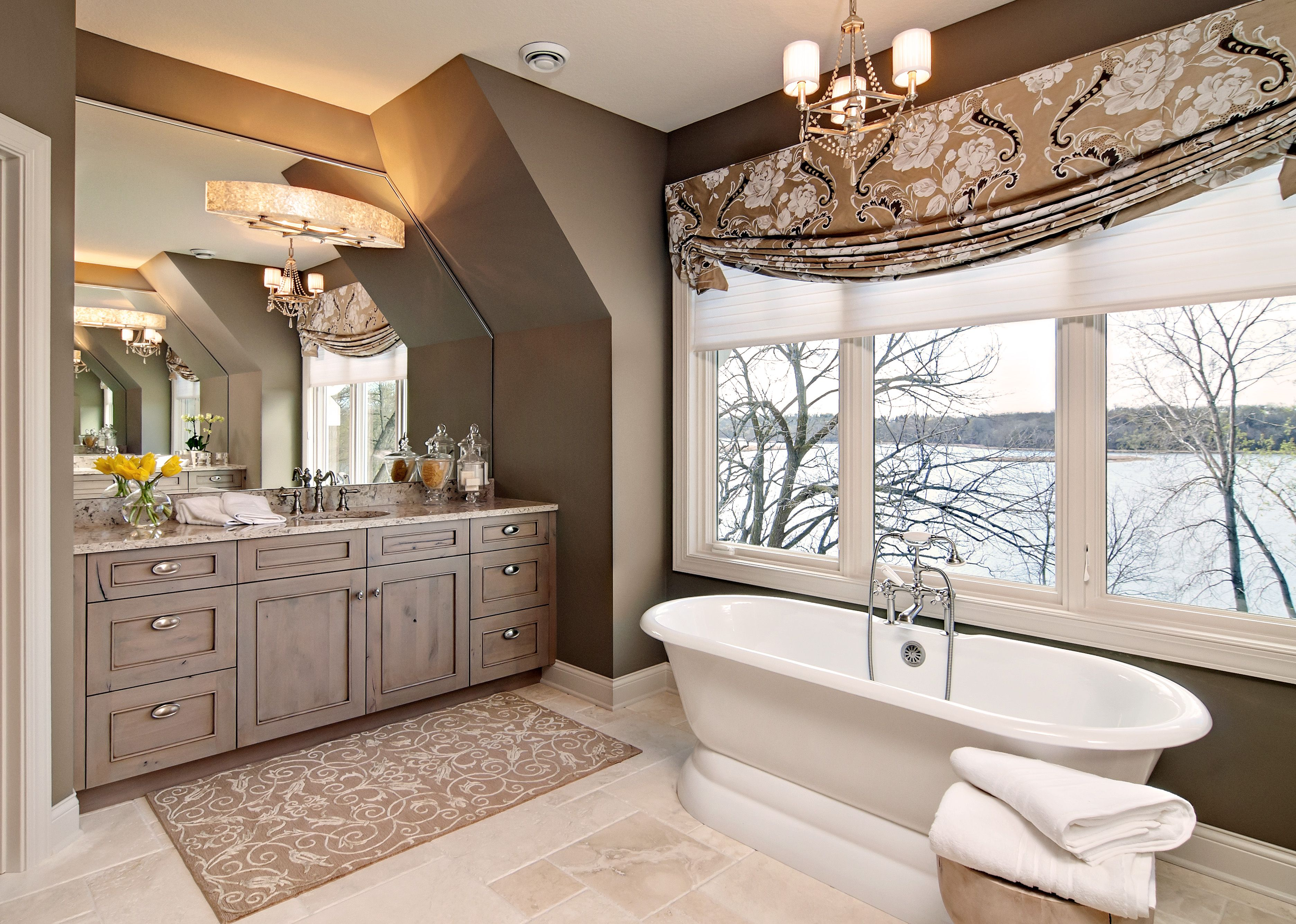 Luxury Bathroom With Freestanding Tub And Bright Windows Overlooking Lake.  Designed By Mingle   Minneapolis Based Public Showroom.