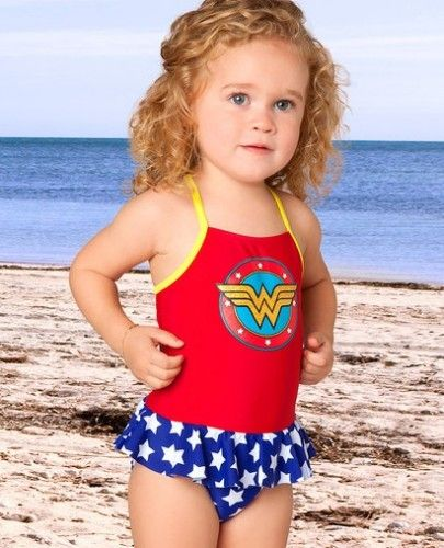 28a56dc7d3f79 Little superheroes will make a splash in this sweet and stretchy swimsuit.  Designed after every girl's favorite crime-fighter, this comfy quick-drying  ...