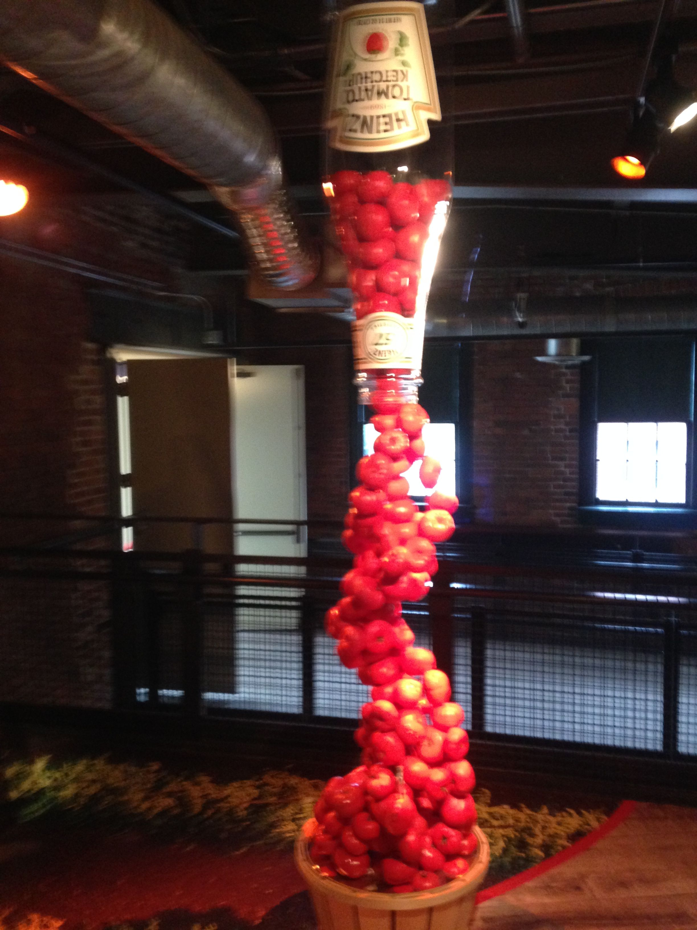 717e6b078 Tomatoes pouring out of Heinz Ketchup bottle on display art - Heinz History  Center - Pittsburgh, PA - July 2018