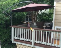 mount a cantilever umbrella outside the deck rail to save ...