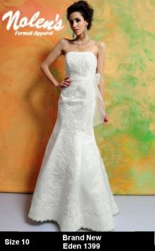 Eden Bridal 1399 Wedding Dress $499.   This is a New, Discontinued Eden Bridal Gown. A classic strapless fit and flare gown in Luxe Satin and lace. The figure hugging shape is dramatically appliqued throughout with lace, and accented at the natural waist with a delicate organza sash. A small sweep train finishes the look.