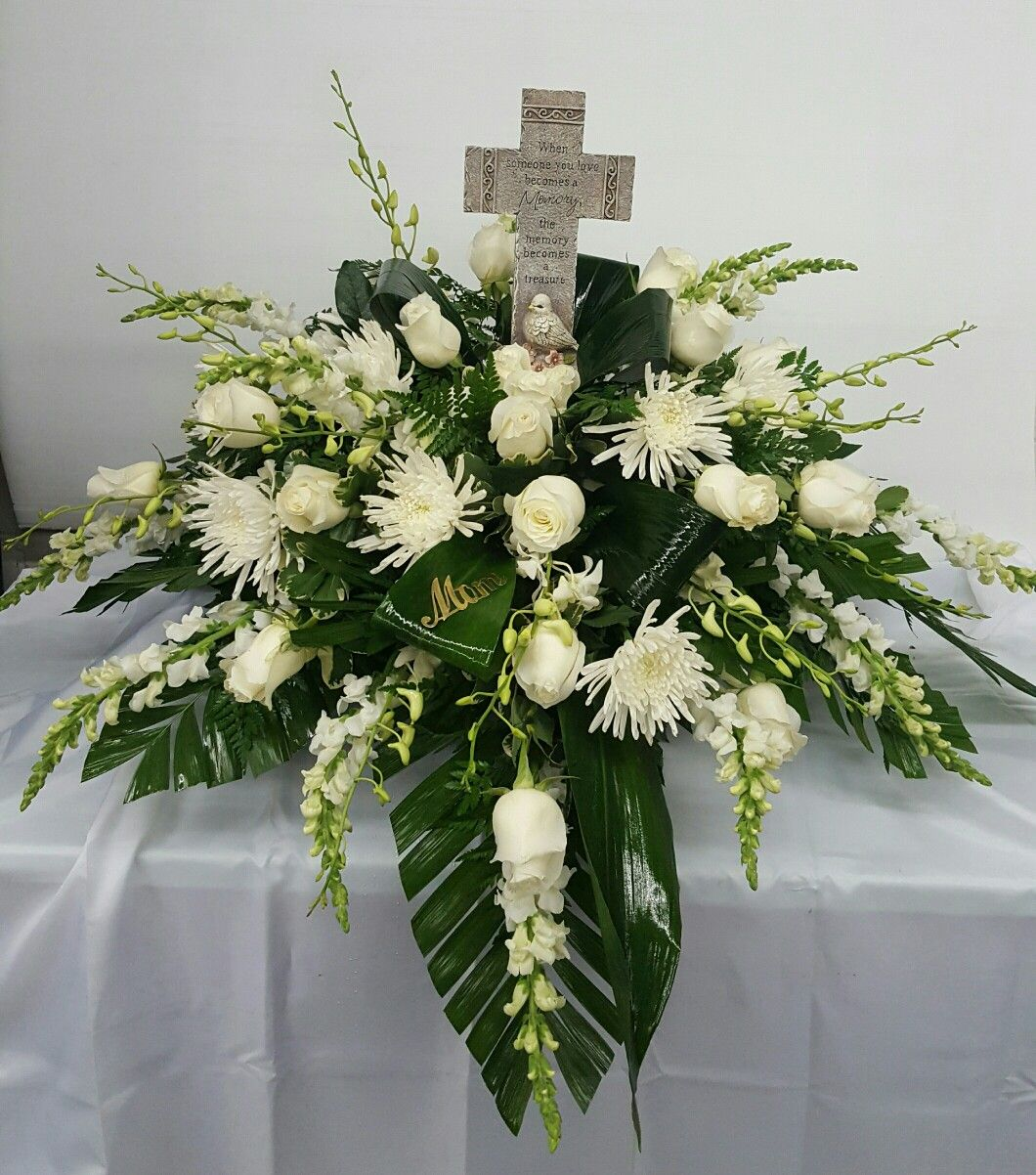 All white flower casket spray with memory cross funeral flowers all white flower casket spray with memory cross izmirmasajfo Image collections