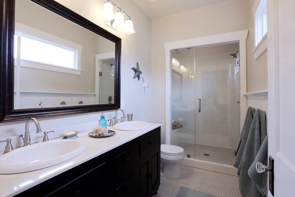 Master bath with large shower and double vanities.