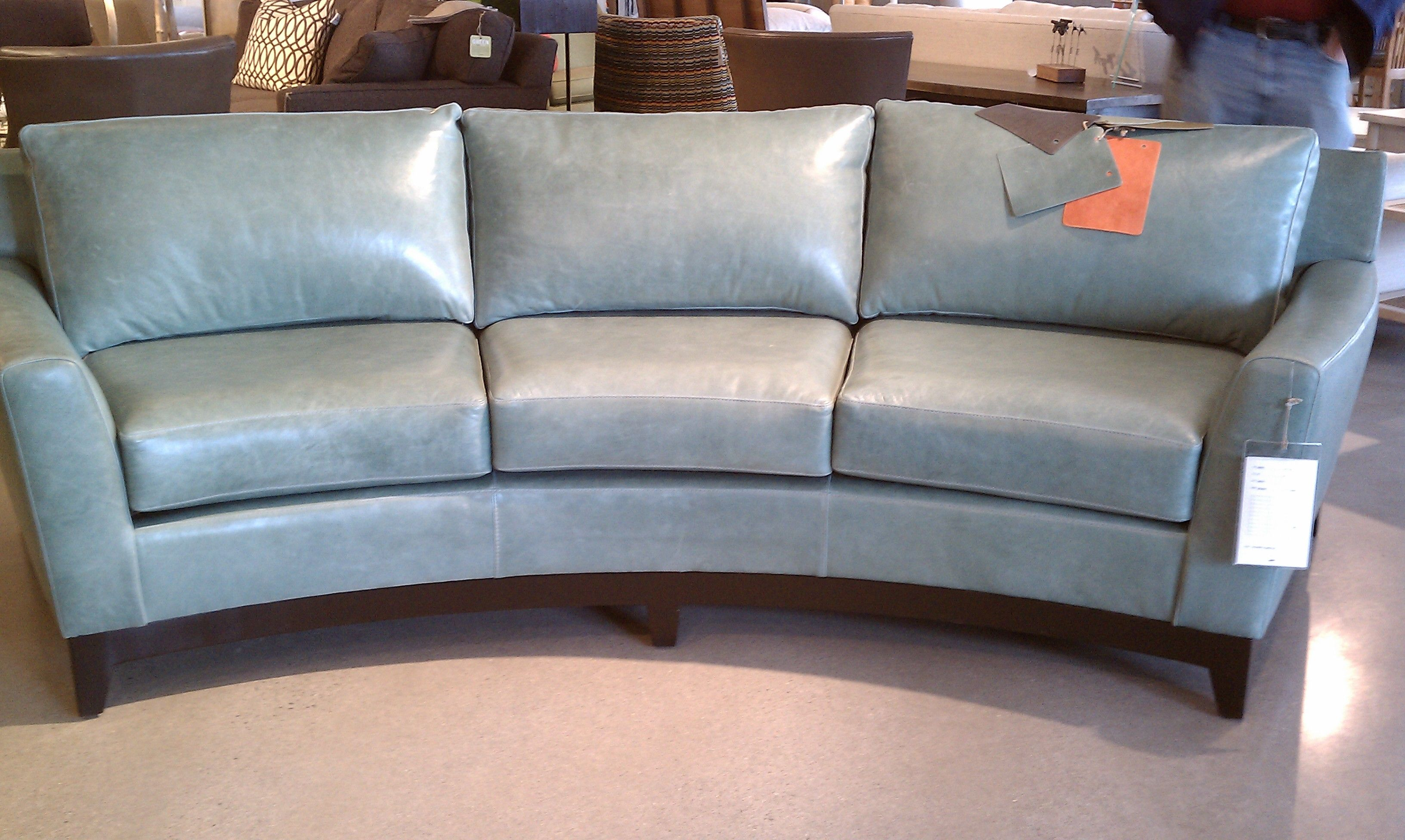 Interesting Curved Leather Couch, Youngs Furniture