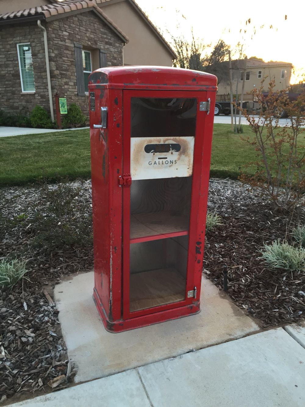 Little free library built from an old gas pump