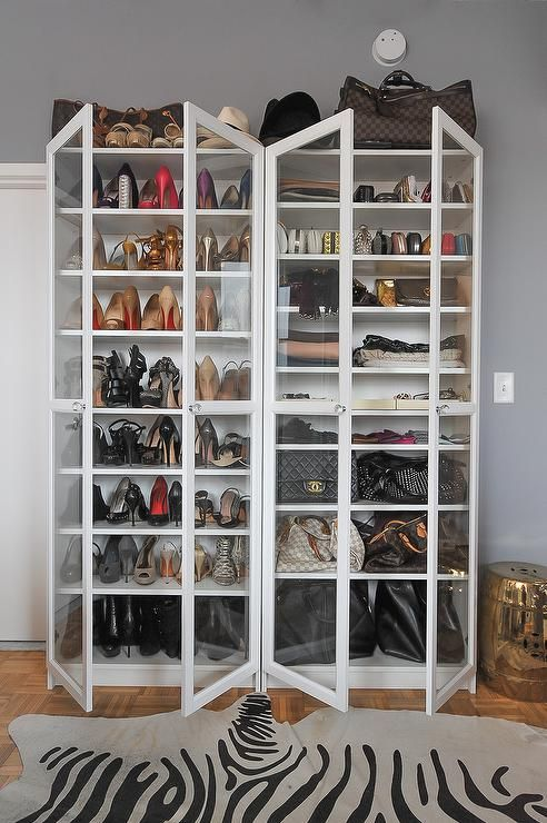 Fantastic Closet Features Side By Side White Freestanding Shoe Cabinets  Fitted With Glass Doors Lined With Shelves Filled With Designer Shoes And  Designer ...