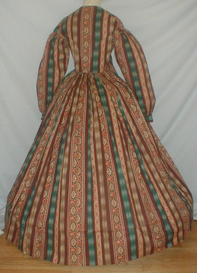 "back - Documented 1860's Cotton print Dress | eBay fiddybee worn by Maria Catherine Blauvelt Ramsey (1823-1902, Ramsey, NJ estate; piping at neck, bust, armscyes & waist, bodice lined with cotton, bodice lining has front hook & eye closure, skirt unlined except wide band of cotton at hem; light underarm discoloration mostly to lining, 5"" period mend on edge of skirt back, front waist enlarged (materinity?); bust: 32""; waist: 30""; skirt length: 41""; hem width: 132"""