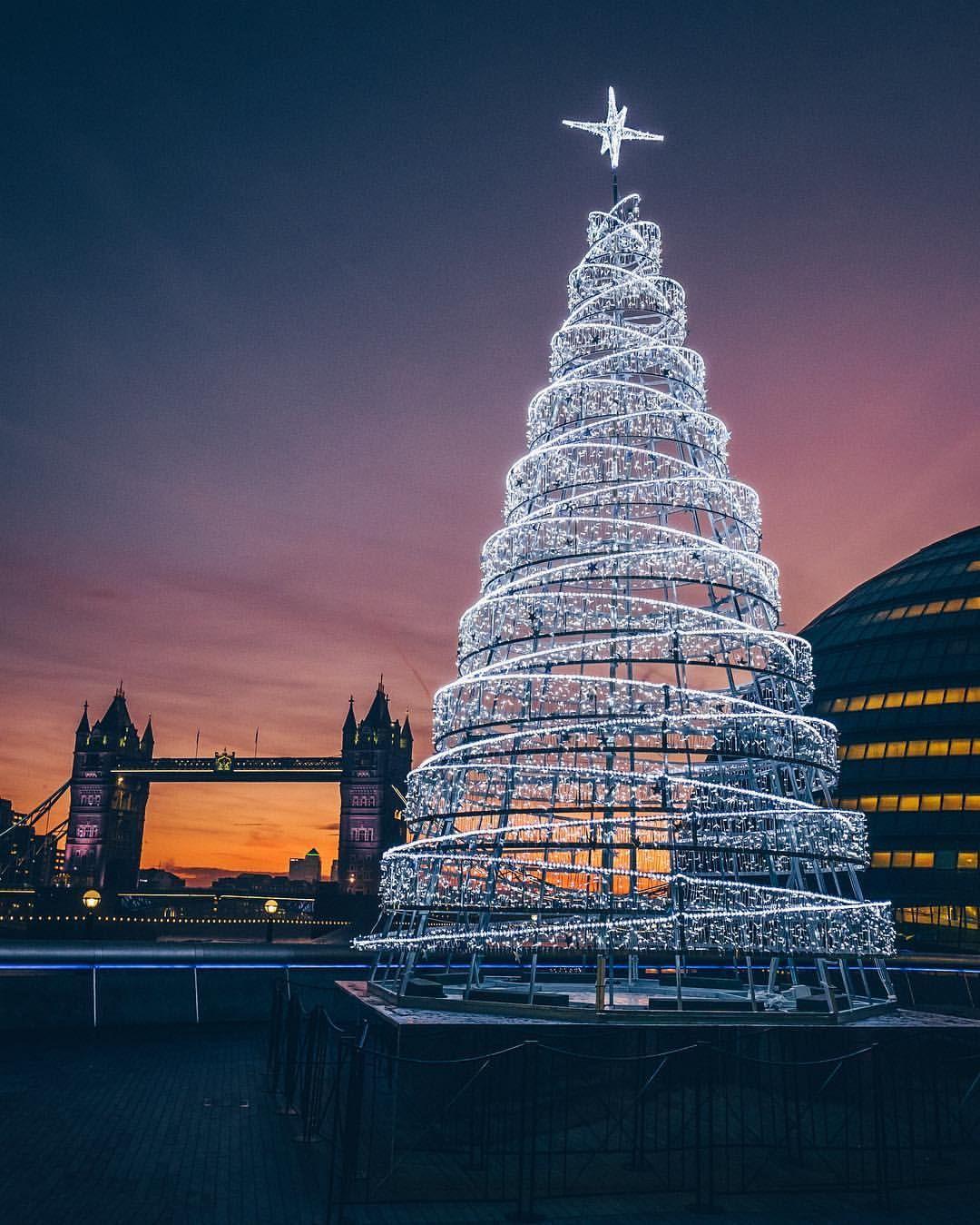 Christmas tree by London's Tower Bridge shot by alanisko on Instagram