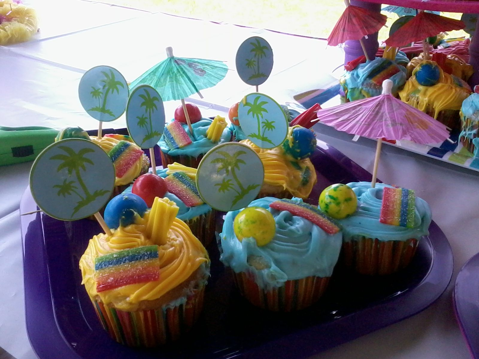 Beach Cupcakes... gumballs = beach balls, extremes = beach towel, twizzlers =  swimming noodles