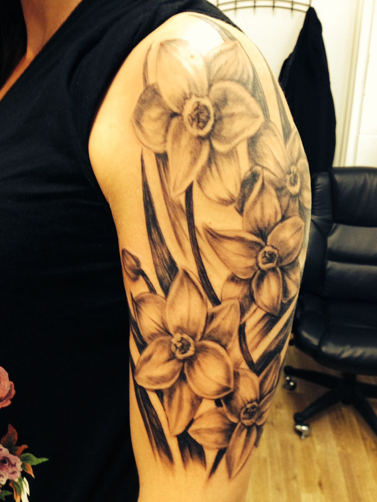 My memorial tattoo for my dad. December birth flower, the