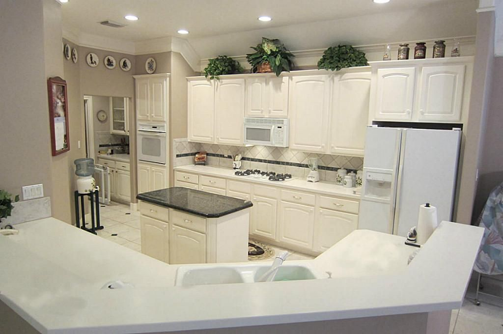 corian counter top with a granite island for contrast corian rh pinterest com