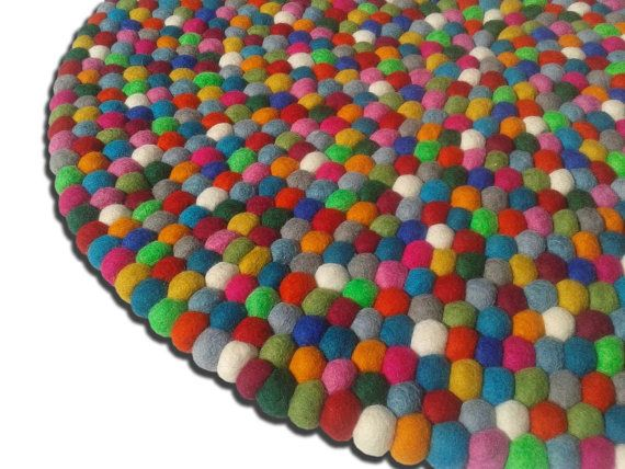 Handmade felt ball rug from Nepal. Made from 100 % wool.    We can make rug in any size,shape and any color combination. If you are interested in