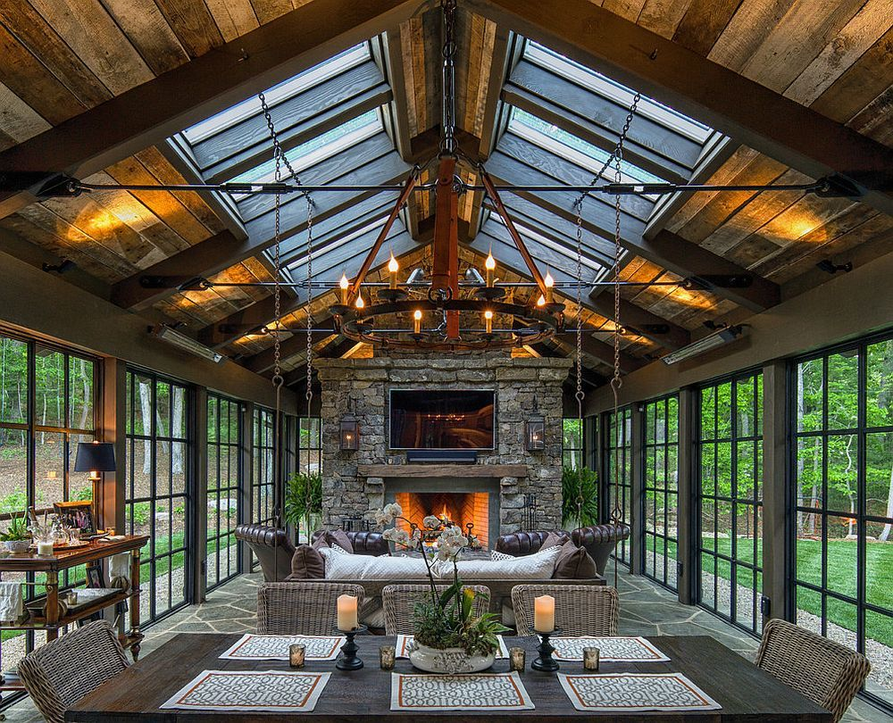 Perfect Skylights Bring In Additional Ventilation Into The Stunning Rustic Sunroom  [Design: Carolina Timberworks]