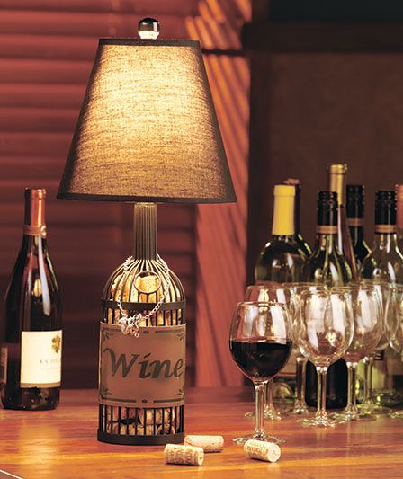 Wine cork basket lamp is perfect for the home of a wine enthusiast topped by a fabric shade the base is shaped like a wine bottle and has a metal wine