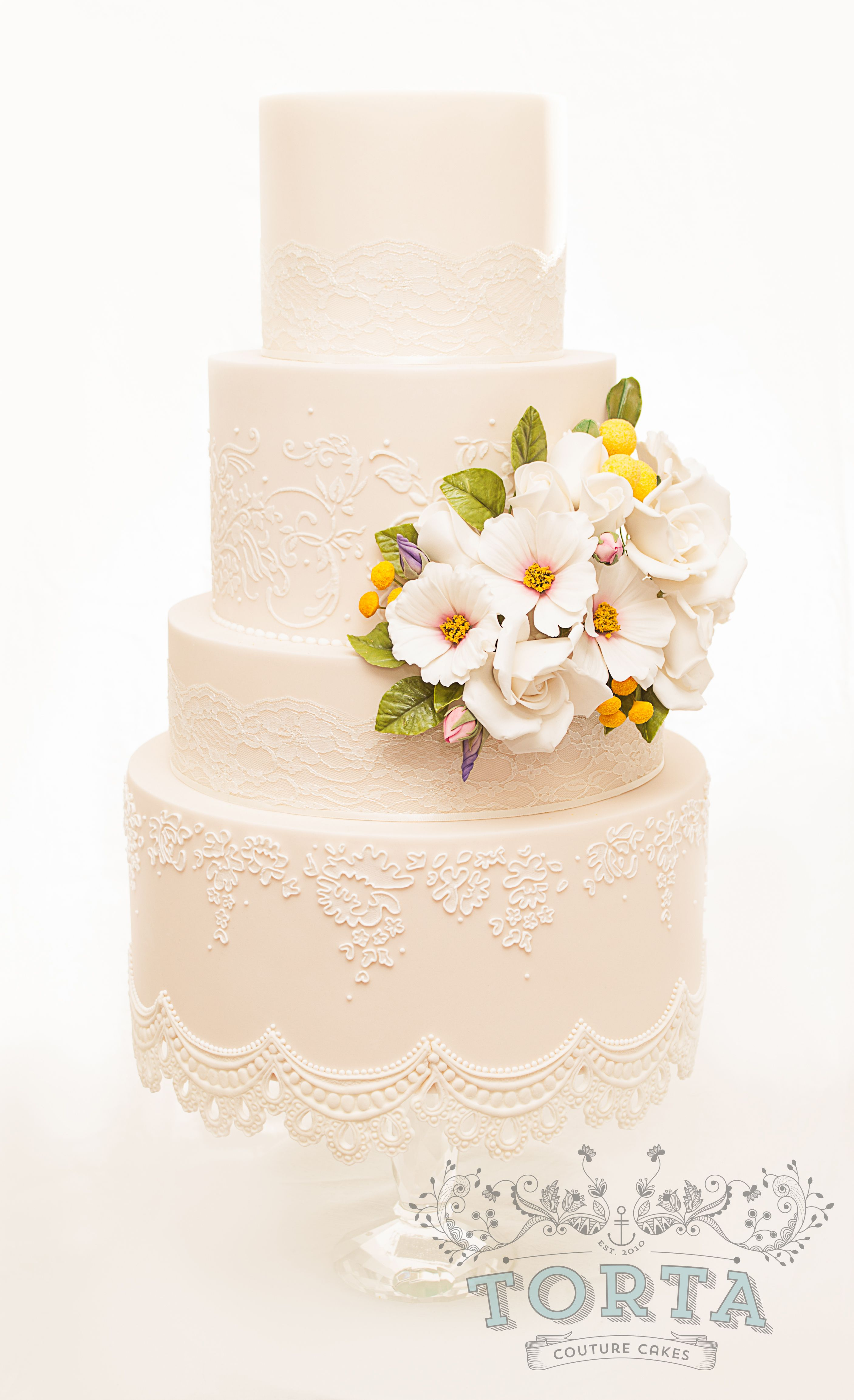 A peach dummy cake made in a vintage style with sugar flowers and ...