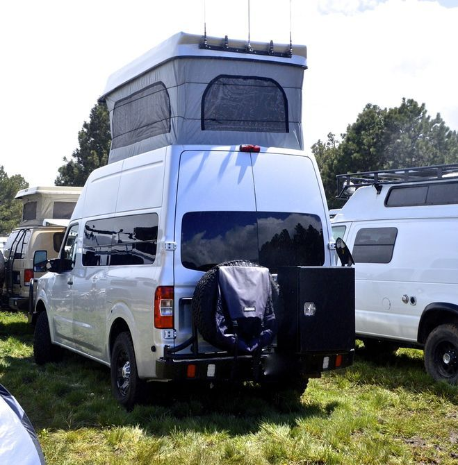 This Nissan camper van was the highest pop-top we saw at the expo