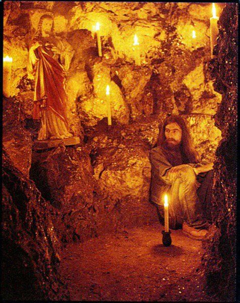 George in a cave at friar park