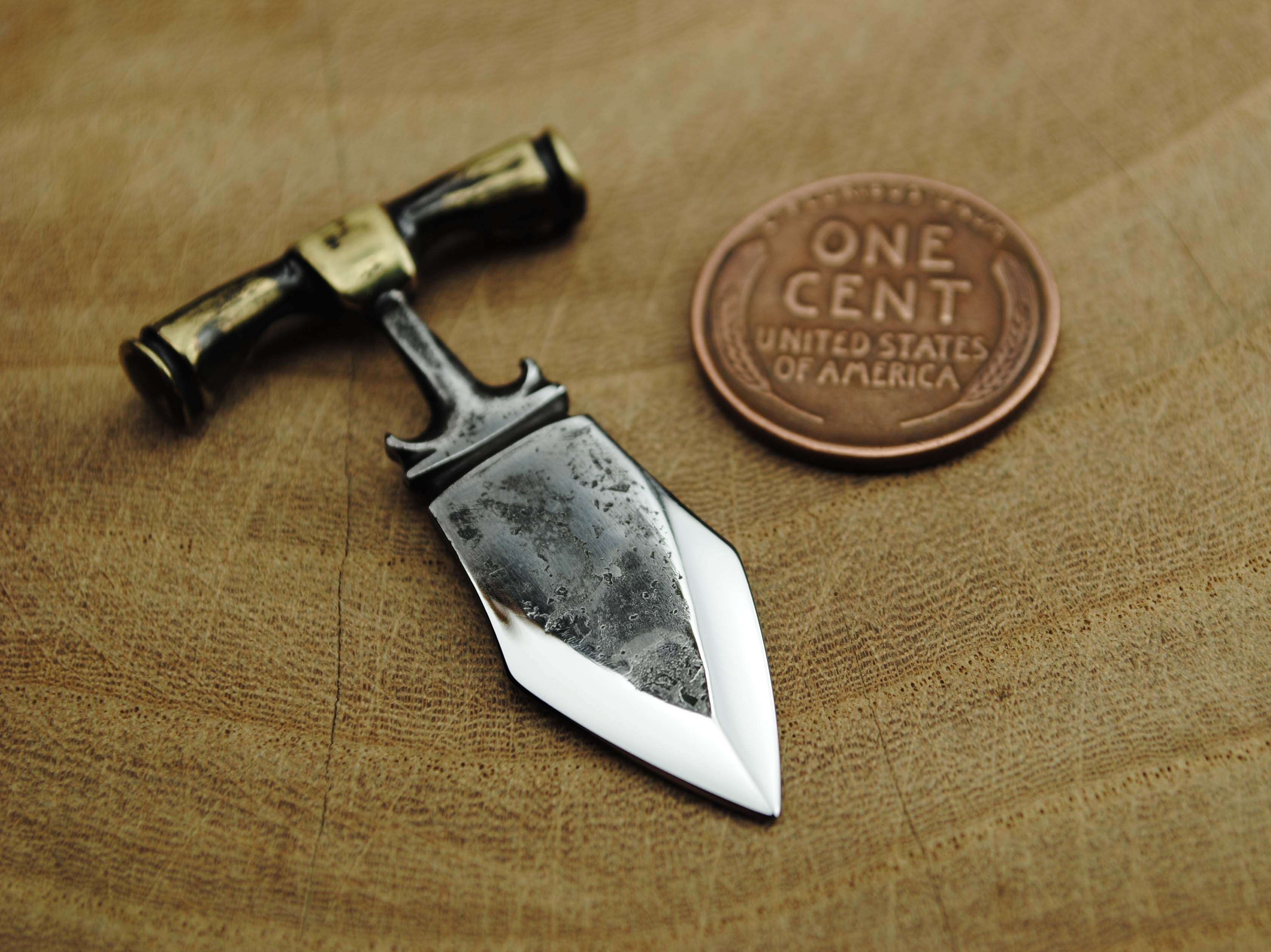 Forget the size, the shape is nice.  Hand forged mini Push Dagger