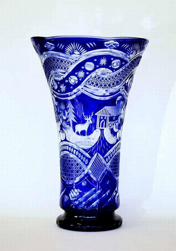 A Large Bohemian Cut Two Layer Glass Vase In Blue And Clear Glass