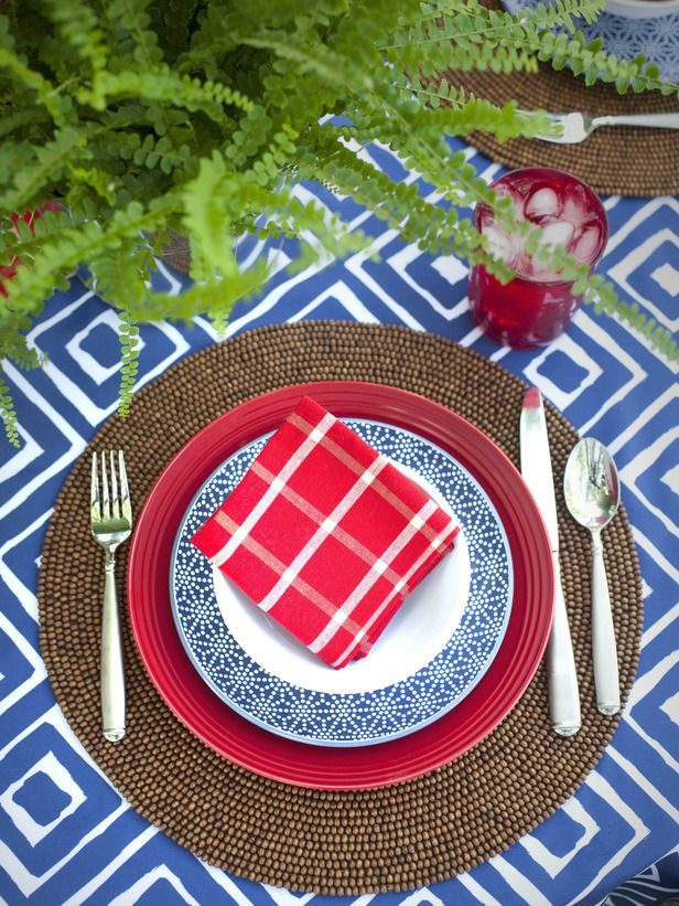 Break up the red, white and blue with a natural woven charger and mix of patterns