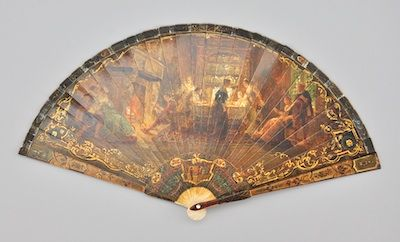 """An Exquisite French Vernis Martin Ivory Fan, ca. 18th Century    Meticulously hand painted, with ivory sticks, featuring elaborate details of a social gathering on recto, and a landscape with ruins of a mountain castle on verso. Unsigned. The fan measures approx. 8""""H when folded, and 14-1/4""""W unfolded."""