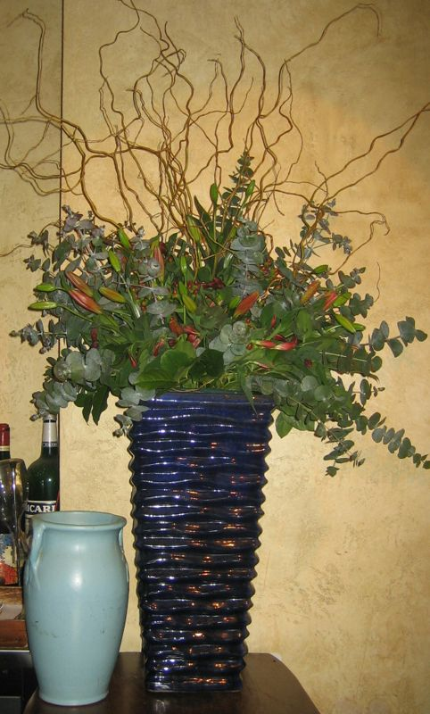 A Large Display Of Red Lilies And Curly Willow Branches See Our Entire Selection At Www Starflor Com To Purchase Any Of Flower Arrangements Flowers Red Lily