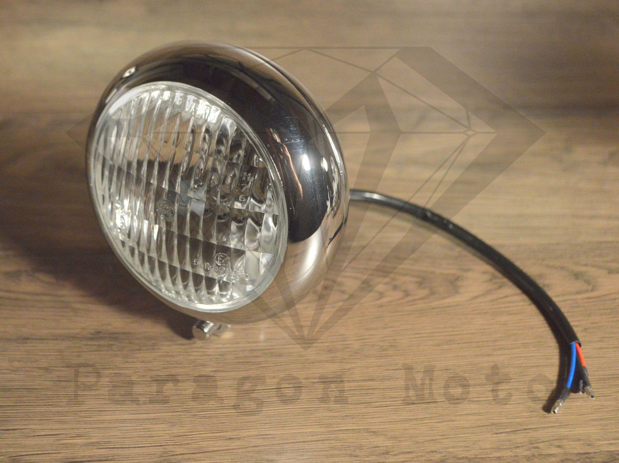 Chrome caddy style bottom mount headlight