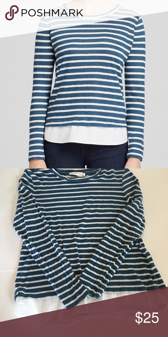 d0fd5d0a4e592 Tory Burch striped long sleeved top Signature Tory Burch design with boat  neck style. Blue and white striped with illusion of white shirt underneath.
