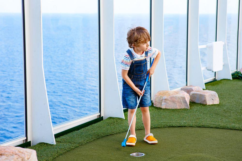 Child on cruise ship playing golf
