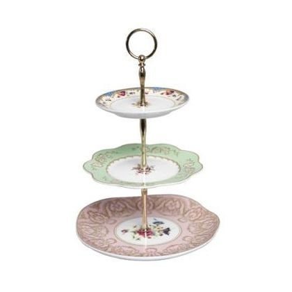 Wish someone would buy me this... I'd use it to store/display my jewelery on my dresser though (my cakes aren't pretty enough for such a cute cake stand)
