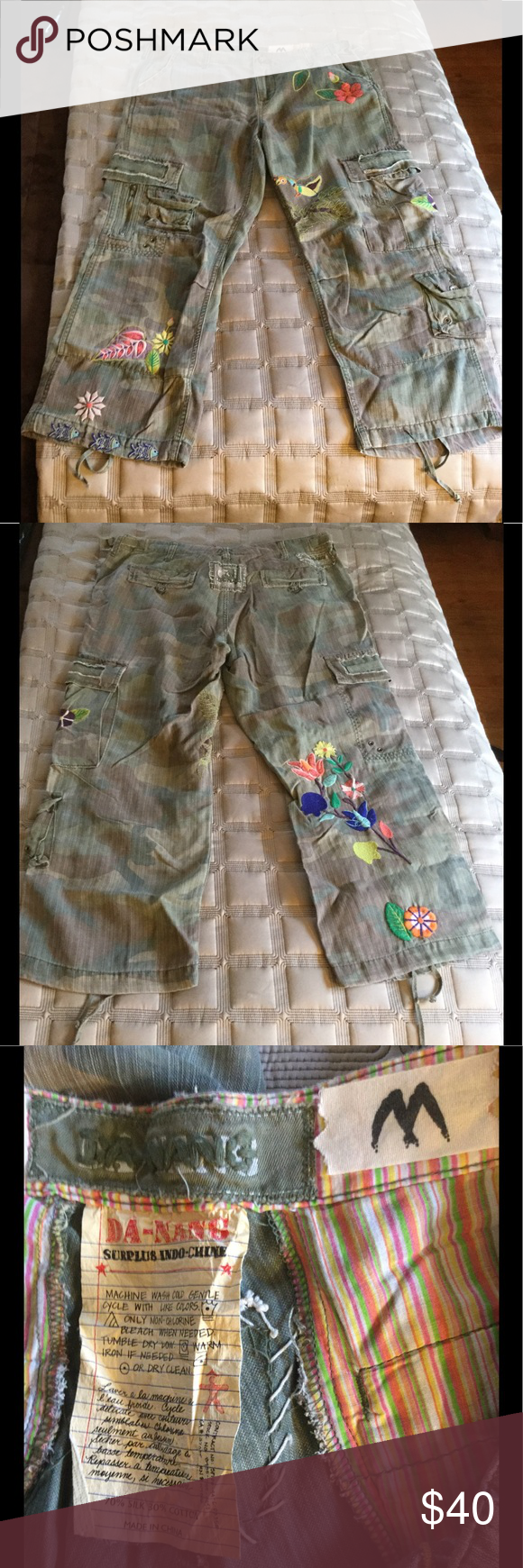 Danang Camo crop cargo w floral embroidery Med EUC Camo with floral 🌸 and bird 🦅 and fish 🐠 embroidery. Cropped length. Cargo style with lots of pockets and details and ties at hem. Super soft silk and cotton fabric. Super cute comfy capris. Excellent condition. Inseam 25 inches. Waist 17 inches across. Danang Pants Ankle & Cropped