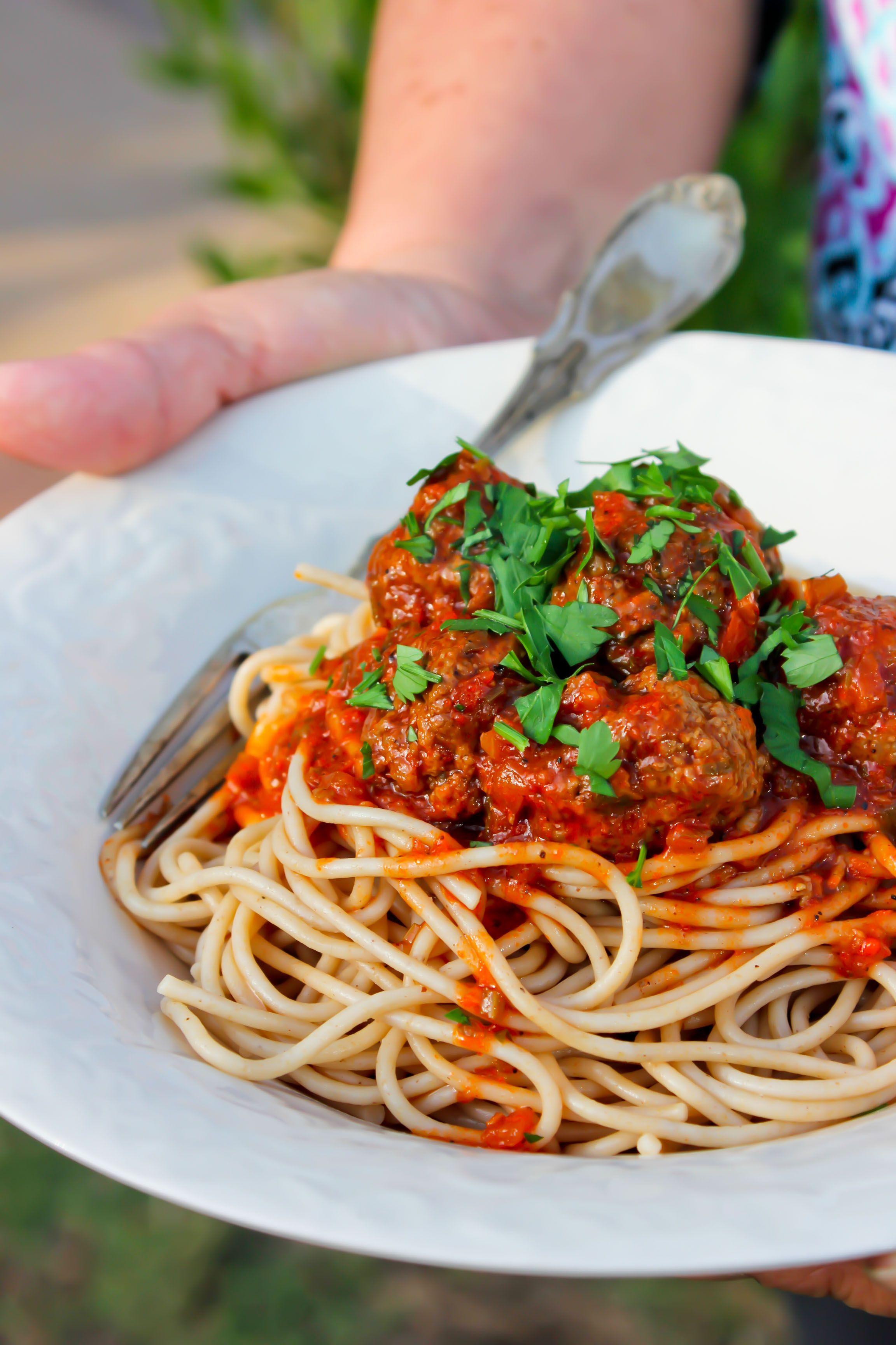 Enjoying A Delicious Meatball Whole Wheat Spaghetti