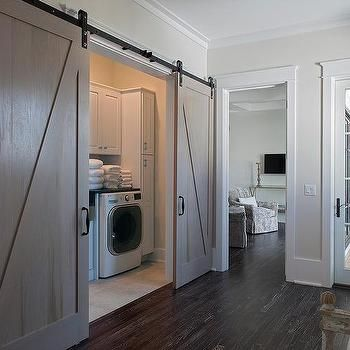 Hall Laundry Room With Gray Wash Barn Doors On Rails Laundry Room Doors Laundry Doors Hidden Laundry Rooms