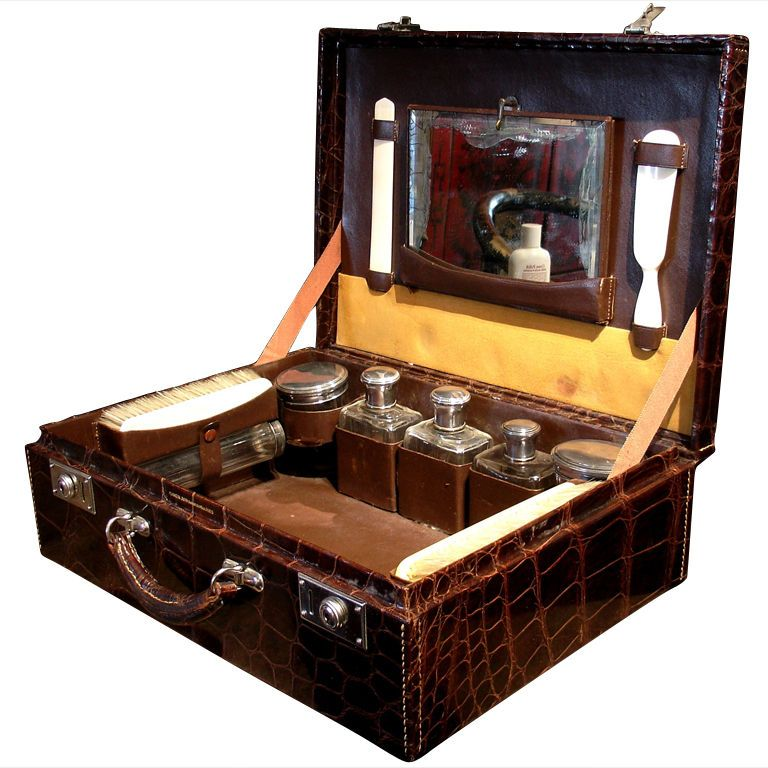b76e1f0ccb SWANK LIVING: Alligator case, ivory brushes, hallmarked fittings. This is  what made travel a delight.