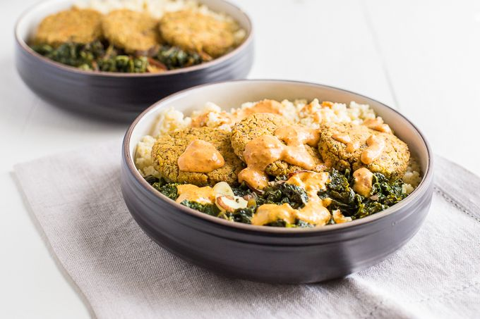 Vegan falafel bowl made with quinoa, date-studded kale and spicy harissa tahini sauce.