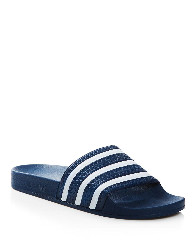 727c4eafa Adidas-Men s Adilette Slide Sandal. Get down to lounge all summer long in  these
