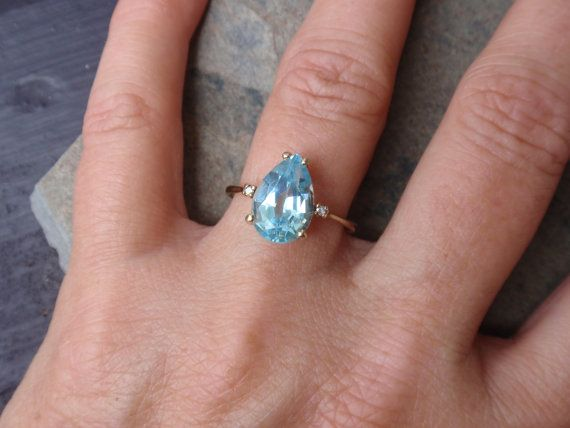 topaz with rings white stones p in blue gold shoulders sky ring asp