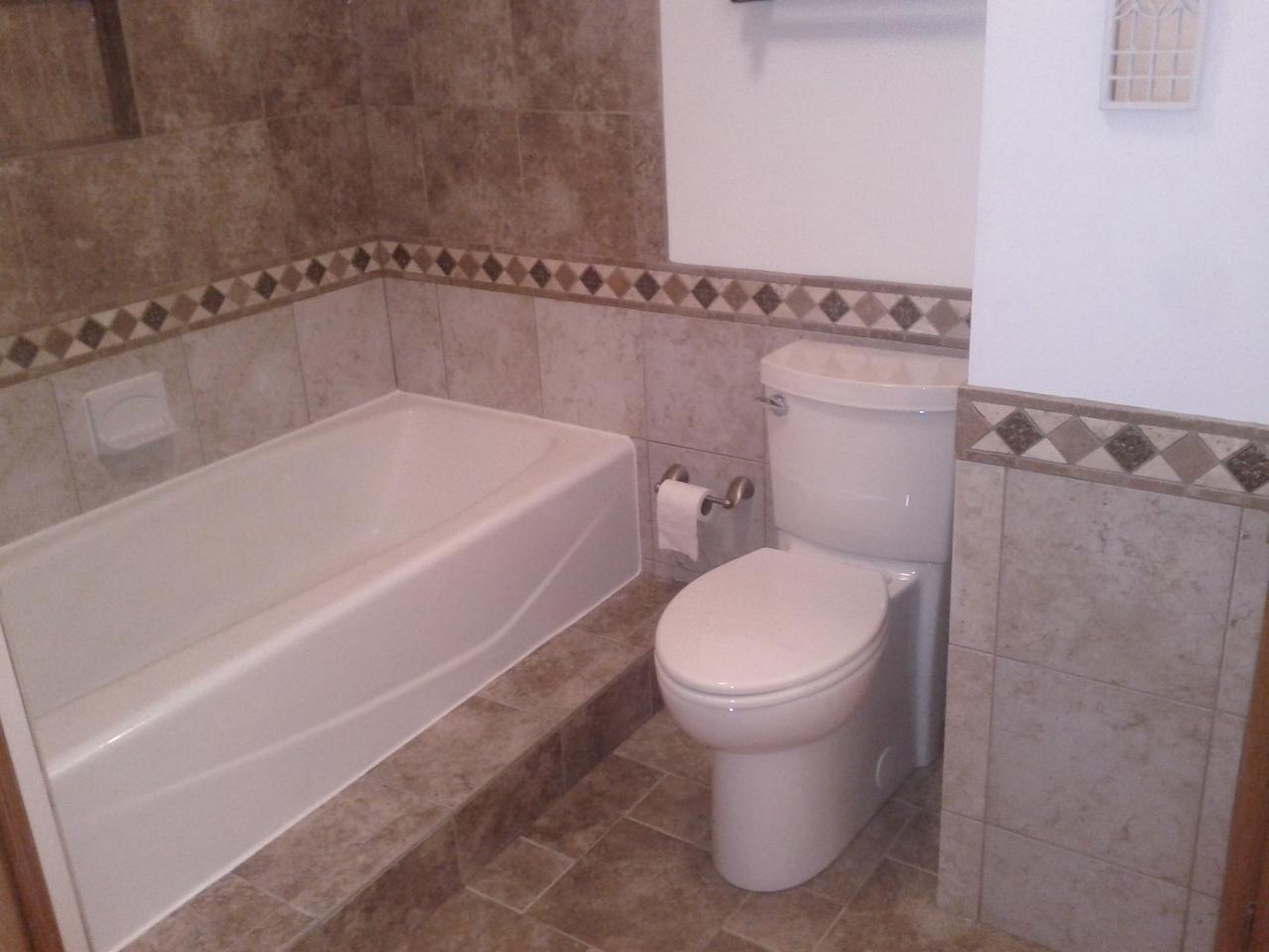 Tile Wainscoting Bathroom tiled waincoating |  is of a bathroom with tile wainscoting