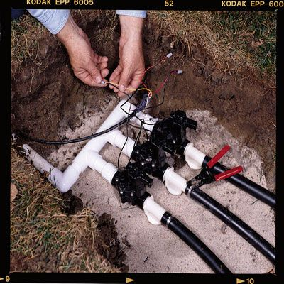 How To Install Your Own Underground Sprinkler System Popular Mechanics Sprinkler And Yards